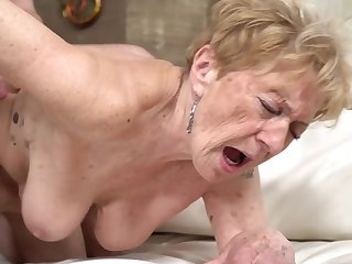 A nasty old granny is getting fucked nigh her pussy doggy style