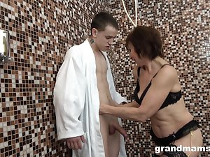 Mature short haired brunette in lingerie doggy fucked in the bathroom