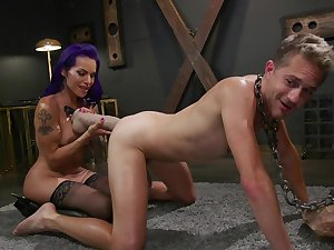 Milf pain in the neck fucks slave and uses huge toys to perform that