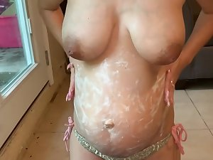 Pregnant humiliation cum on her broad in the beam belly