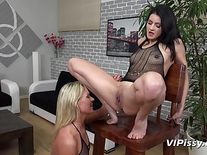 Lesbian pissing action with long legged bitches