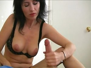 Mature brunette pleasures the brush pussy and strokes the brush lover's dick