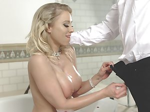 After bathing big breasted MILF is ready to give a nice titjob to her stud