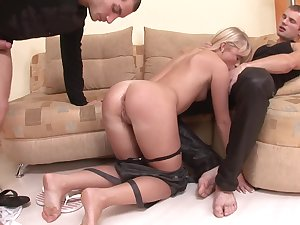 Teen Alisa B. on her knees getting fucked hard by two rock hard dicks