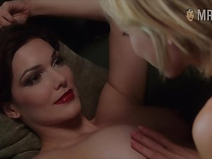 Honcho demiurge Laura Harring enjoying some steamy sapphic fun unaffected by the couch