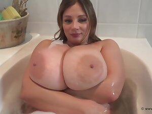 Big titted wench is having a relaxing bath in front of the camera and enjoying it