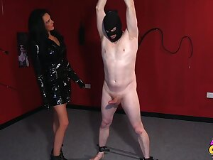 Astonishing woman in a Negro dress and high heels is effectuation with her sex slaves flannel