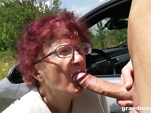 Nerdy mature redhead is so happy to with reference to a proper blowjob outdoors