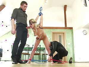 Blonde woman faced with her first maledom threesome
